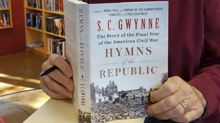 Larry Siegel holds a book