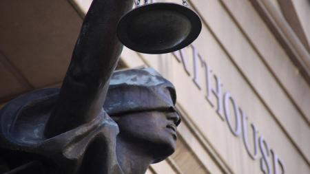 statue of justice outside court building