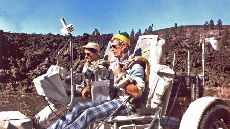 Gene Cernan and Jack Schmitt drive rover by the Bonita Lava Flow near Sunset Crater.