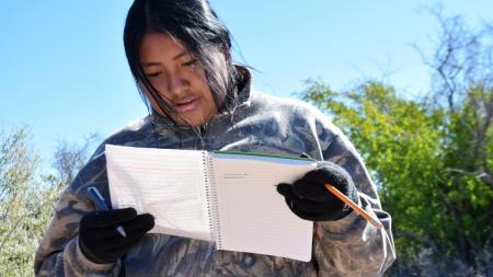 Kenya Estrella takes down tree measurements