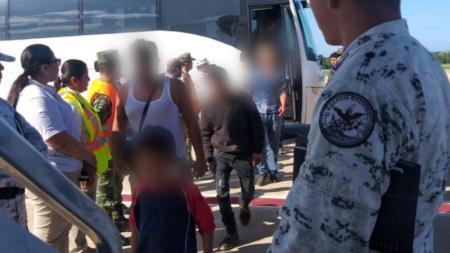 Mexico's National Guard escorts migrants