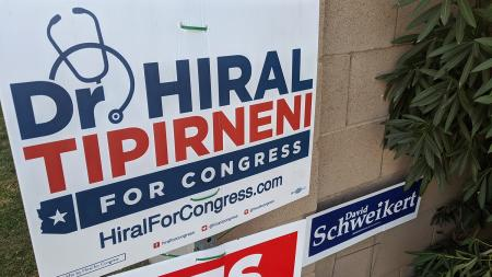 Signs for Rep. David Schweikert and challenger Hiral Tipirneni
