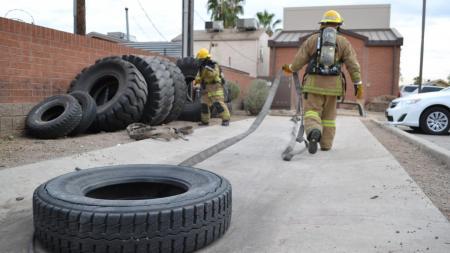 firefighter pulls tire