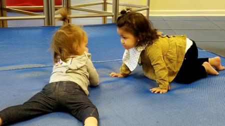 toddlers playing on blue mat