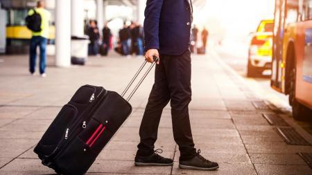 Traveler at airport curb