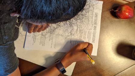 kid working on homework