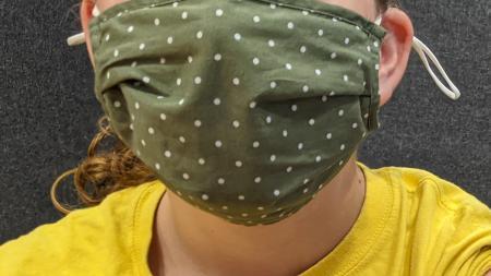 child wearing a mask