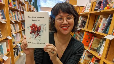Michelle Malonzo with Undocumented Americans book