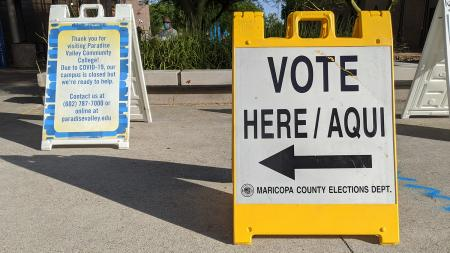 A sign directing voters